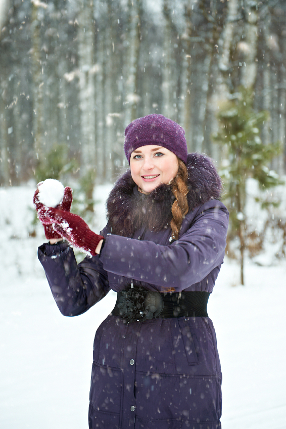Young woman playing in snowball fights